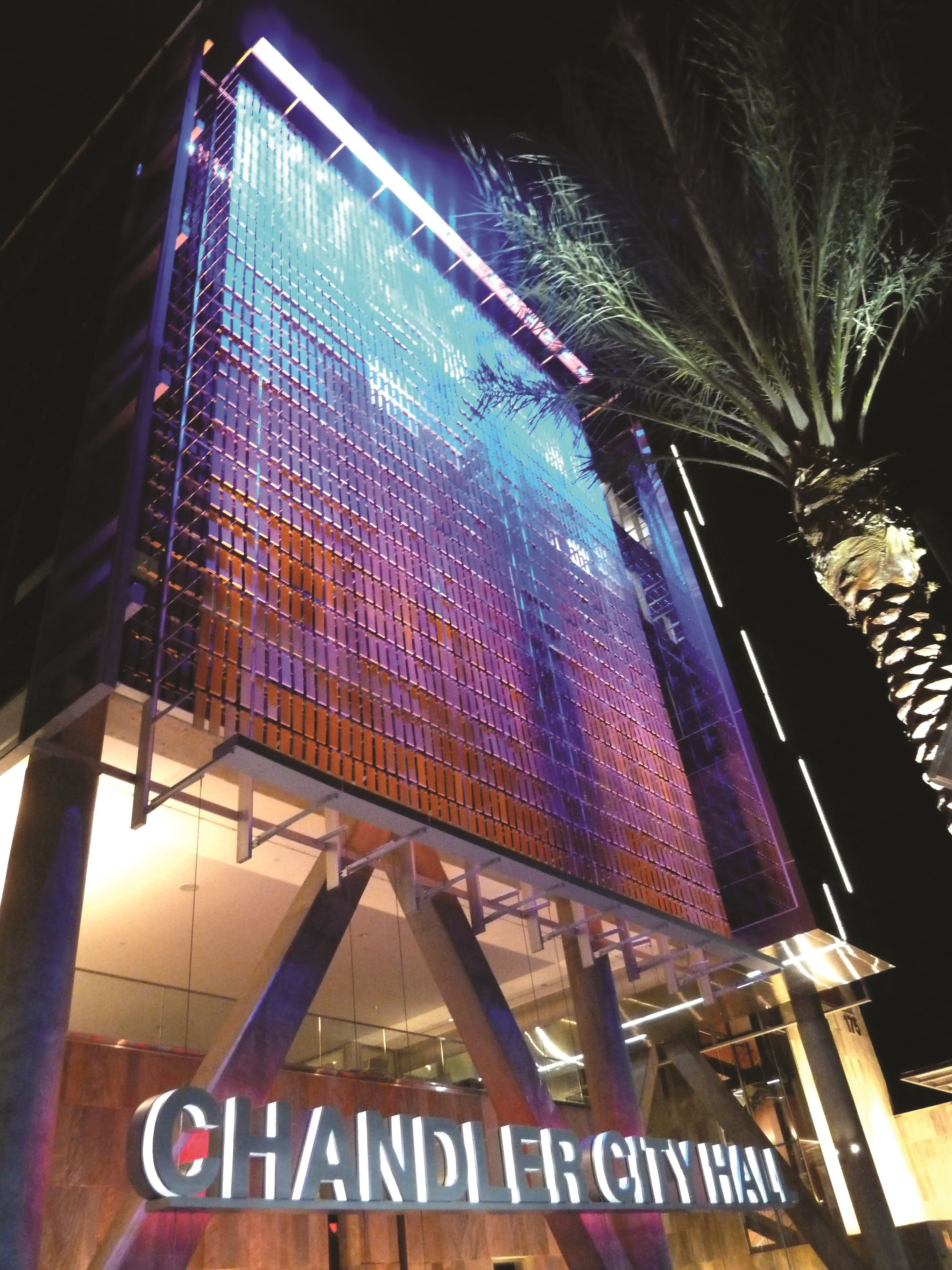 View of Perforated facade lit with LED lights