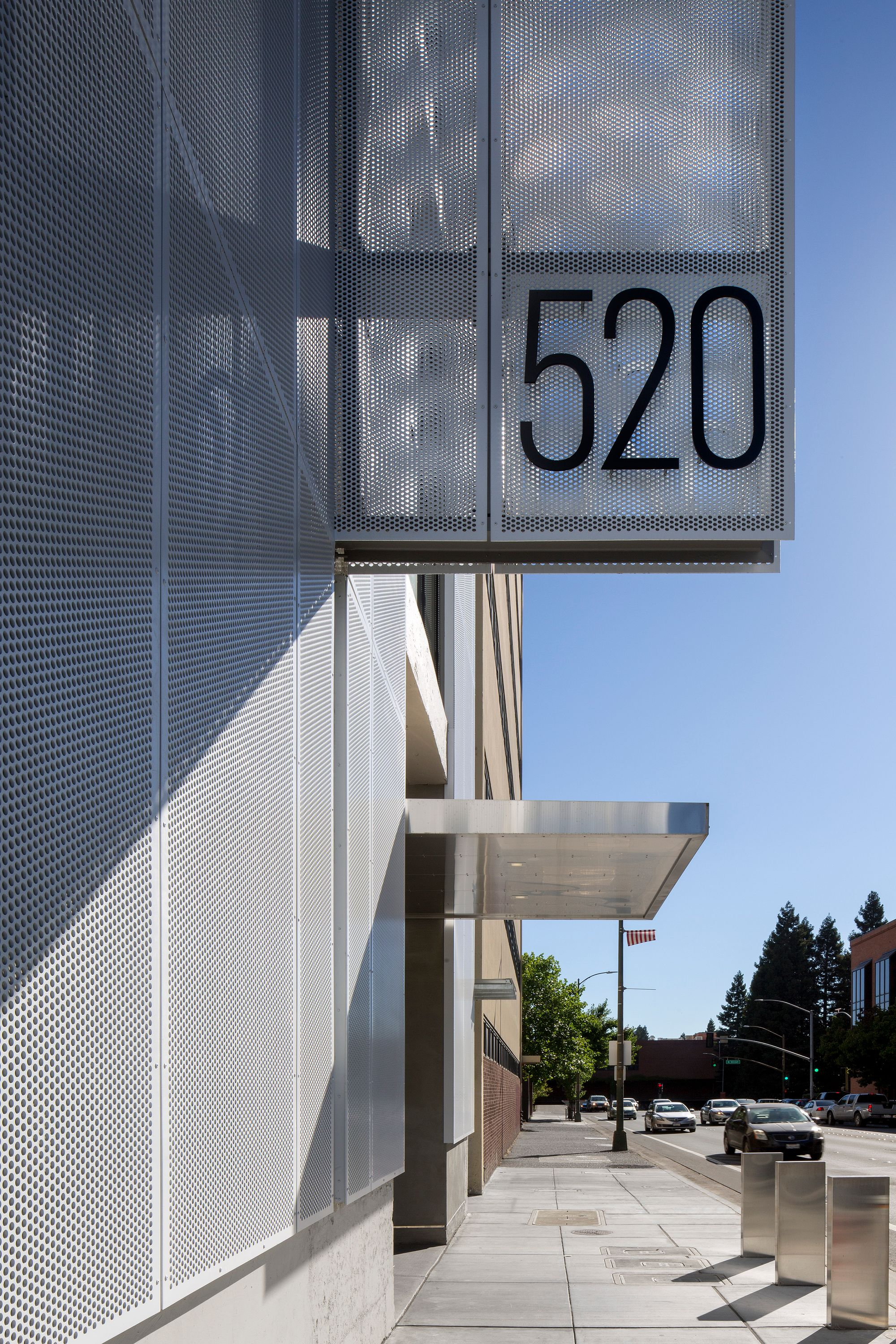 Perforated panels enhance building facade and sign