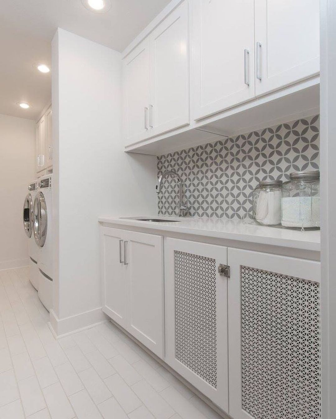 Designer Perforated metal panel infills used in a modern laundry room