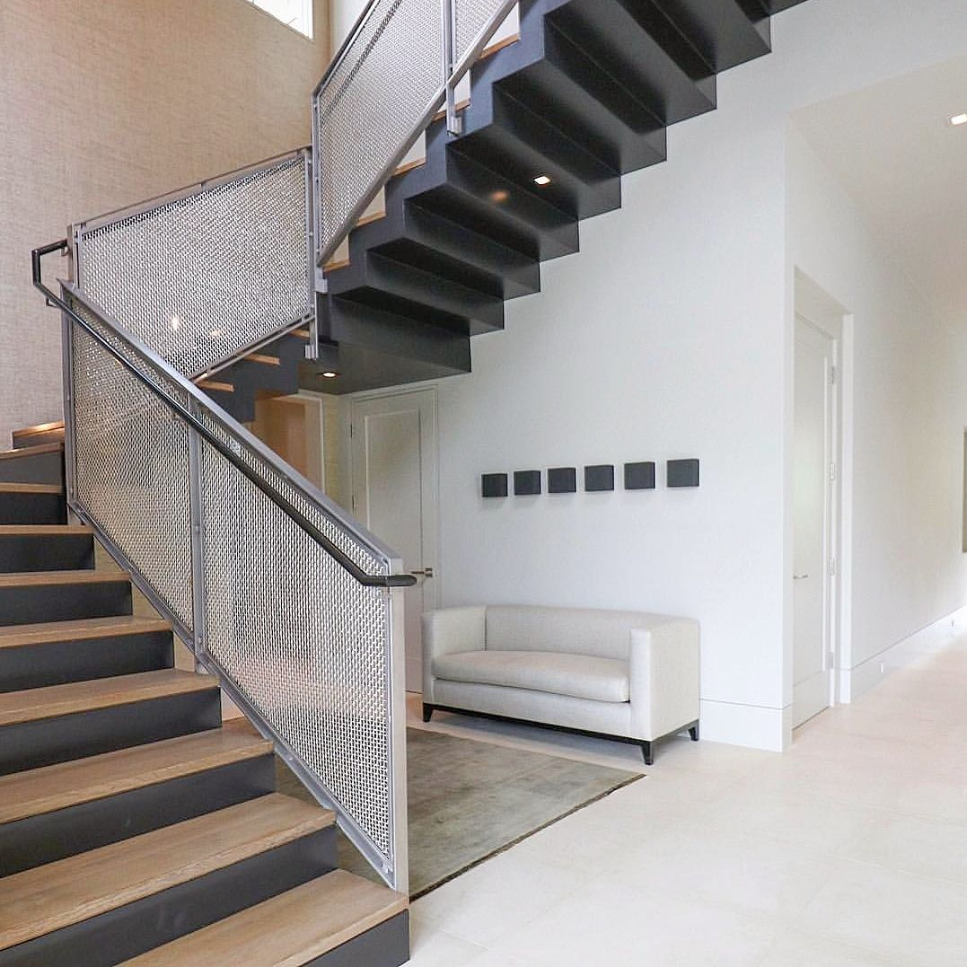 Designer Perforated metal infill panels used to create staircase railings