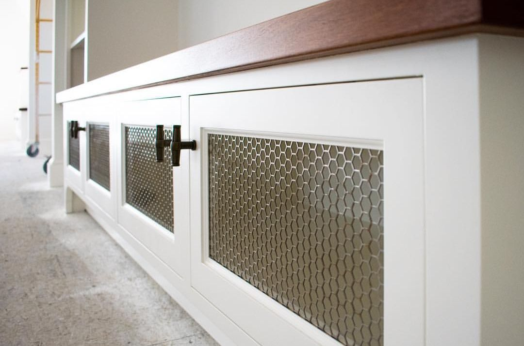 Hexagonal Designer Perforated metal infill panels used in an entertainment center