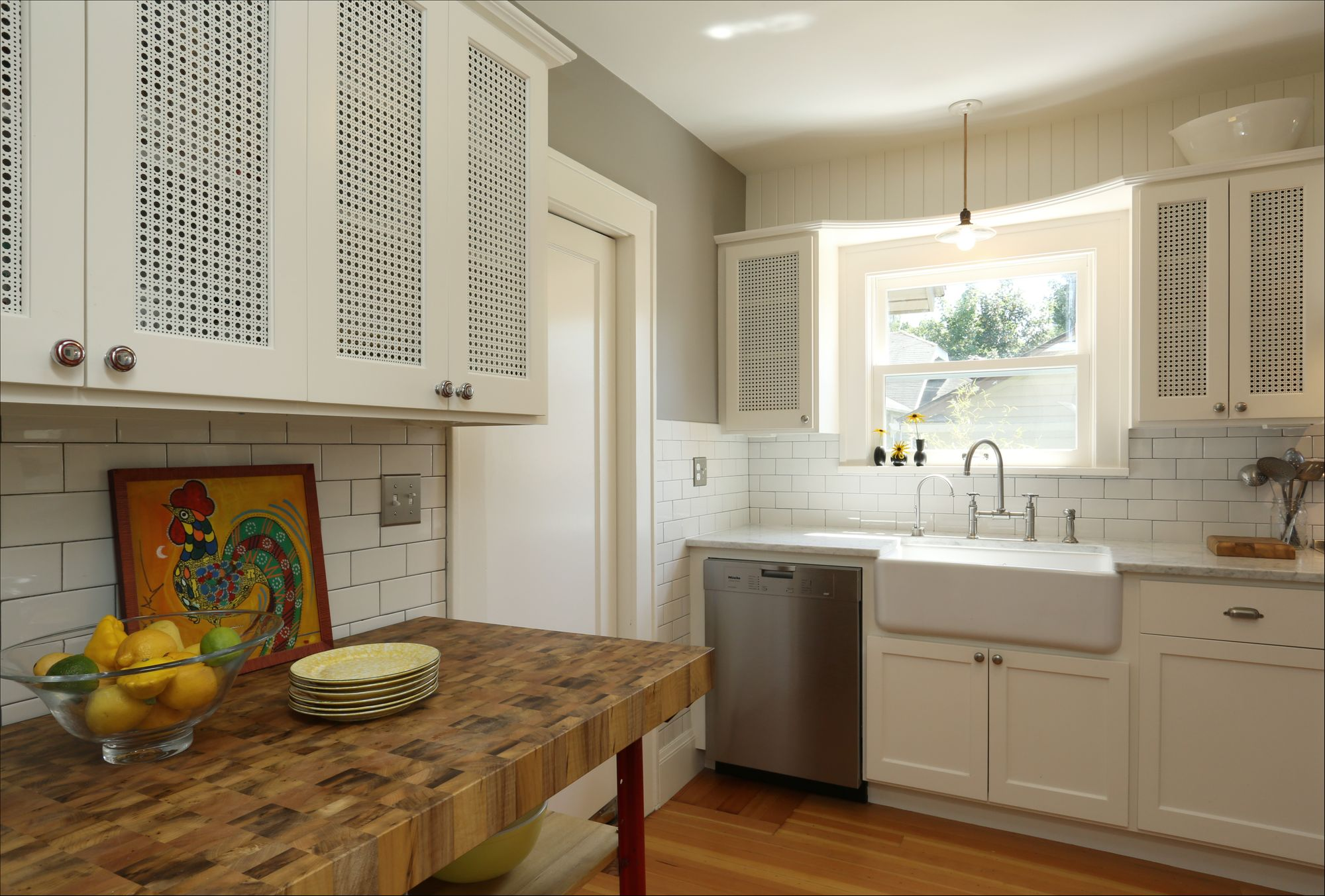 Designer Perforated metal infill panels used to create semi-open kitchen cabinets