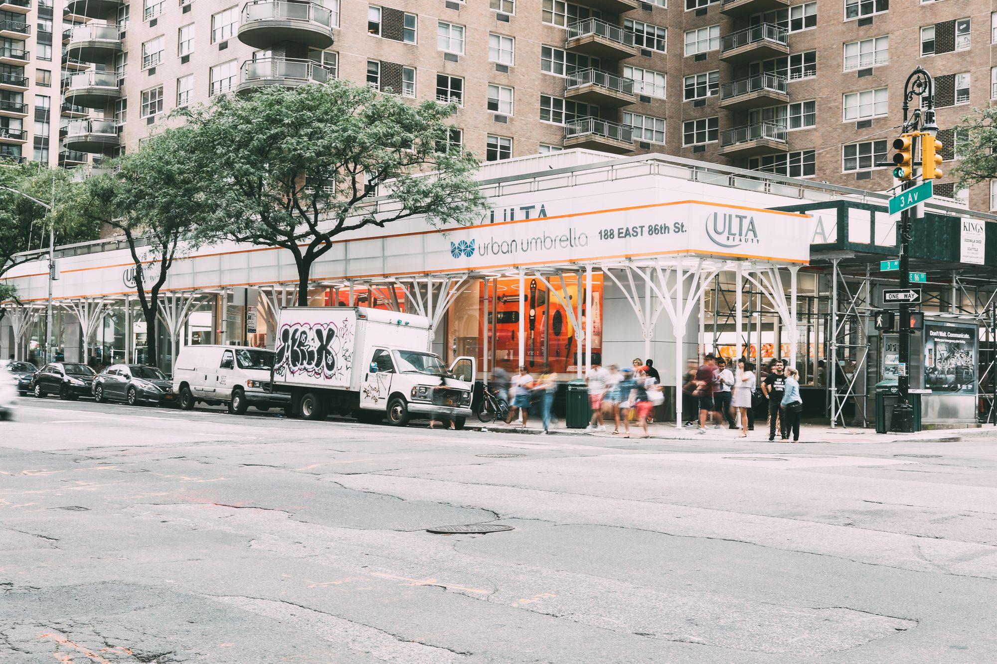 Urban Umbrella parapets create a space for custom brand signage.