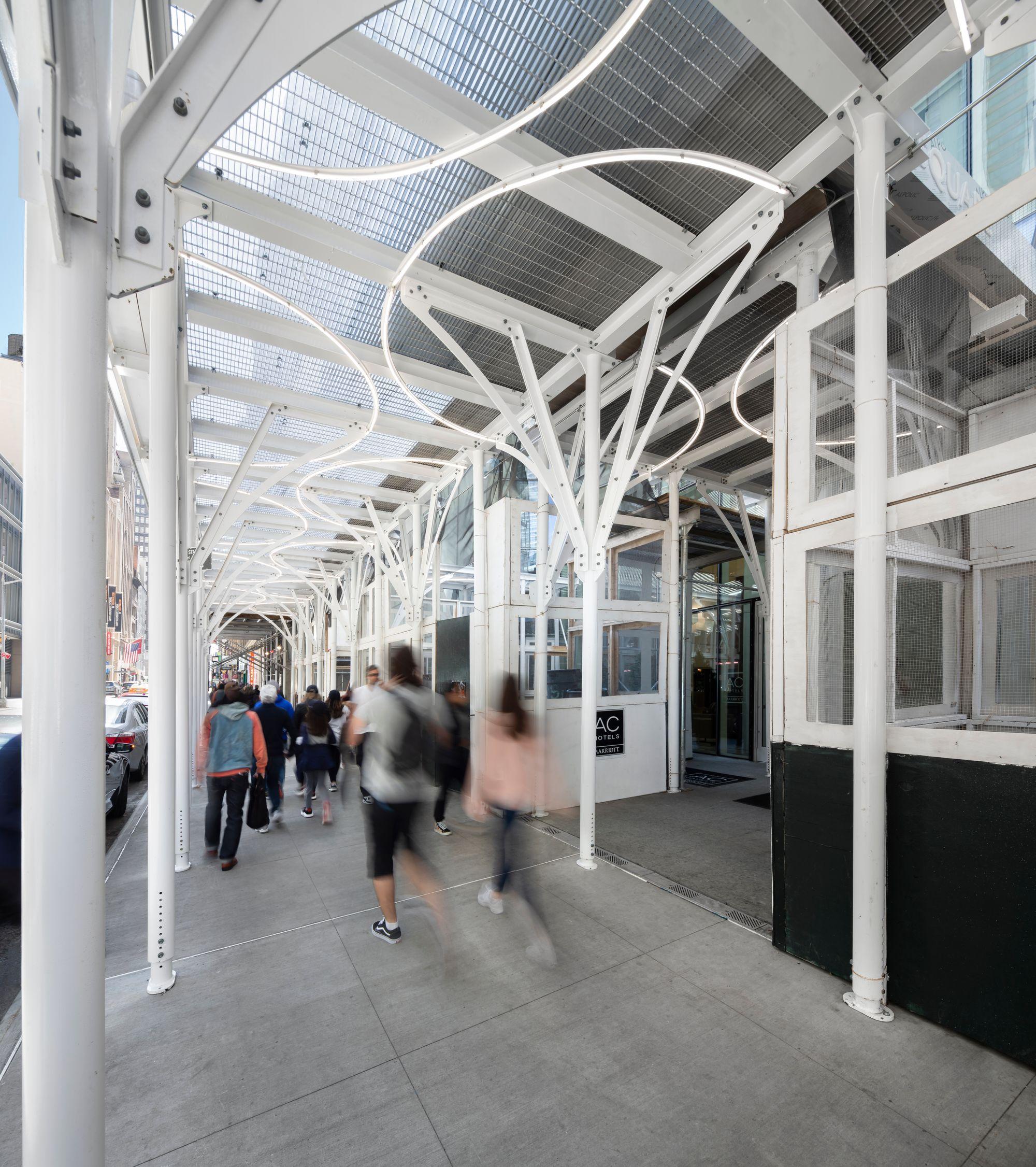 Urban Umbrella scaffolding lines a sidewalk in New York City