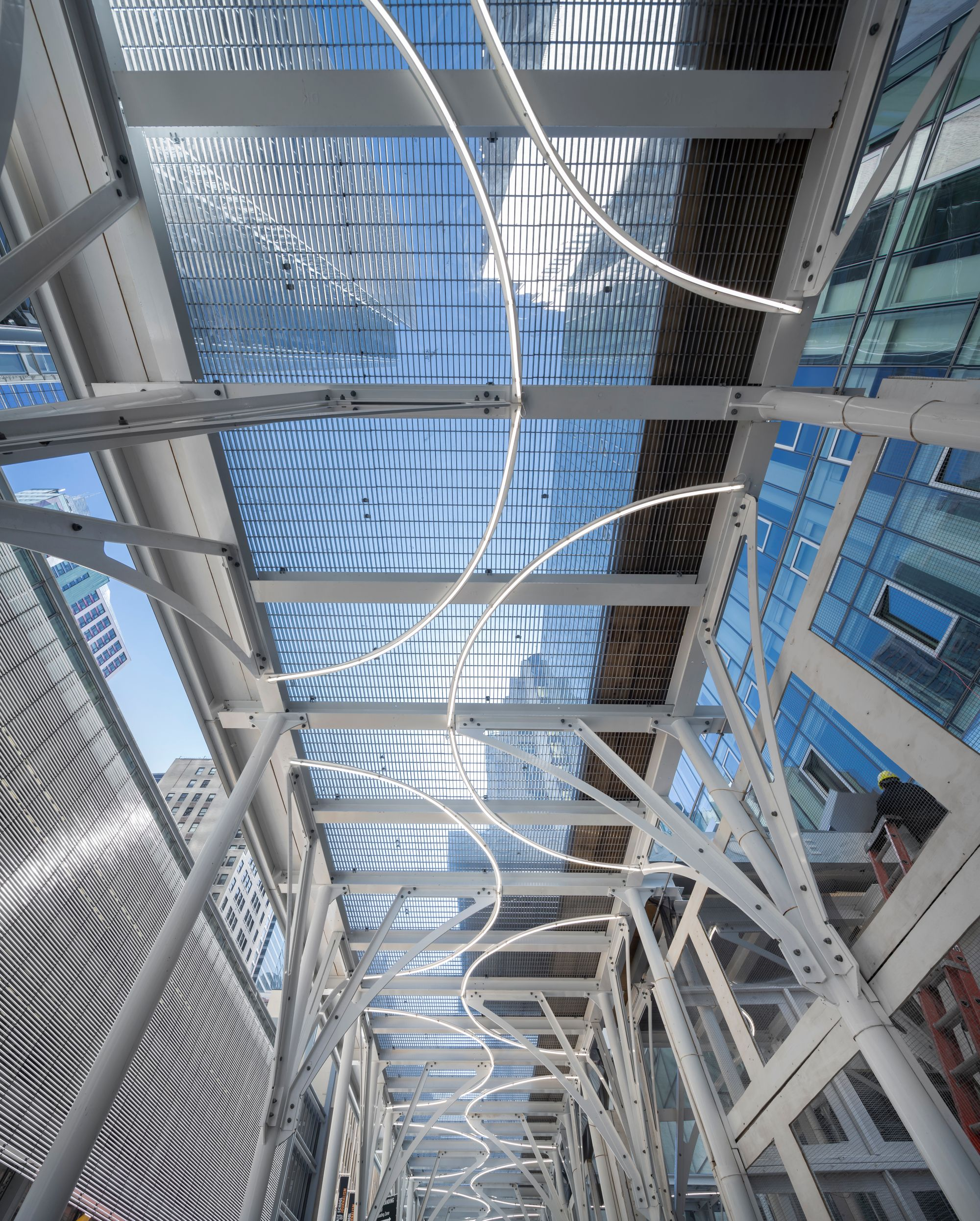 Urban Umbrella ceilings, assembled with McNICHOLS® Bar Grating and translucent plastic, enable skyward views and the passage of light.