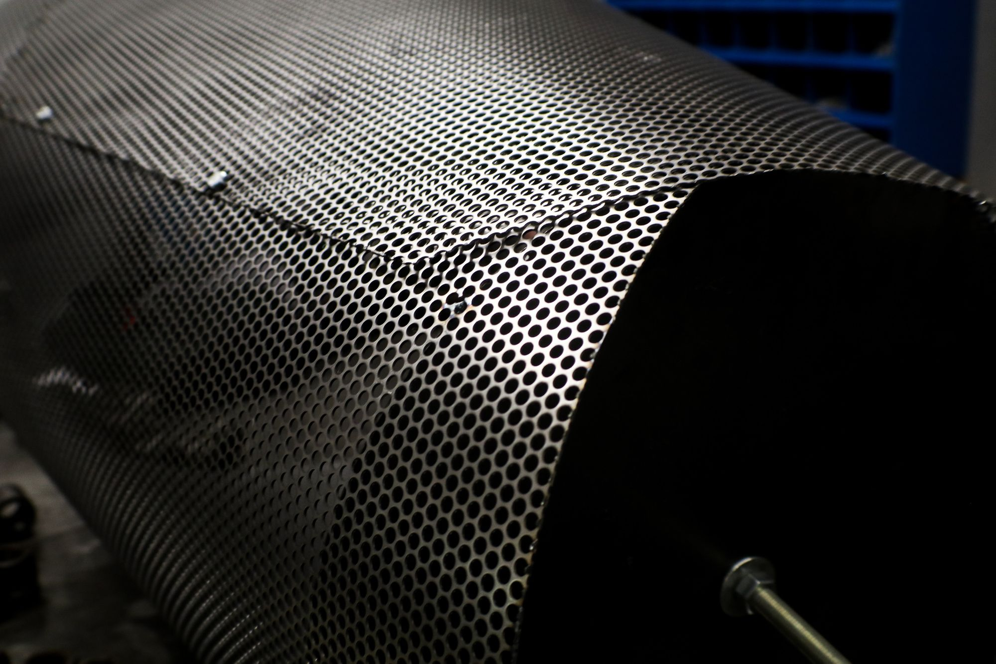 Perforated Metal being molded into lighting fixture design