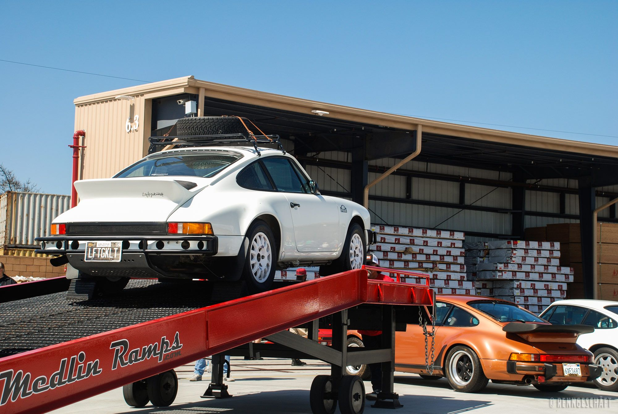 Mobile yard ramp by Medlin Ramps with a white car atop it