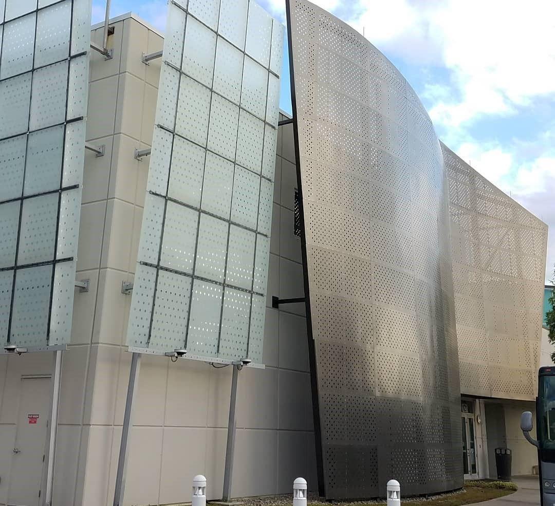 a wall of perforated metal at Full Sail University in Orlando, Florida