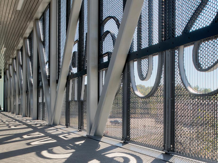 Perforated metal panels surrounding the Sugar Creek Station bridge