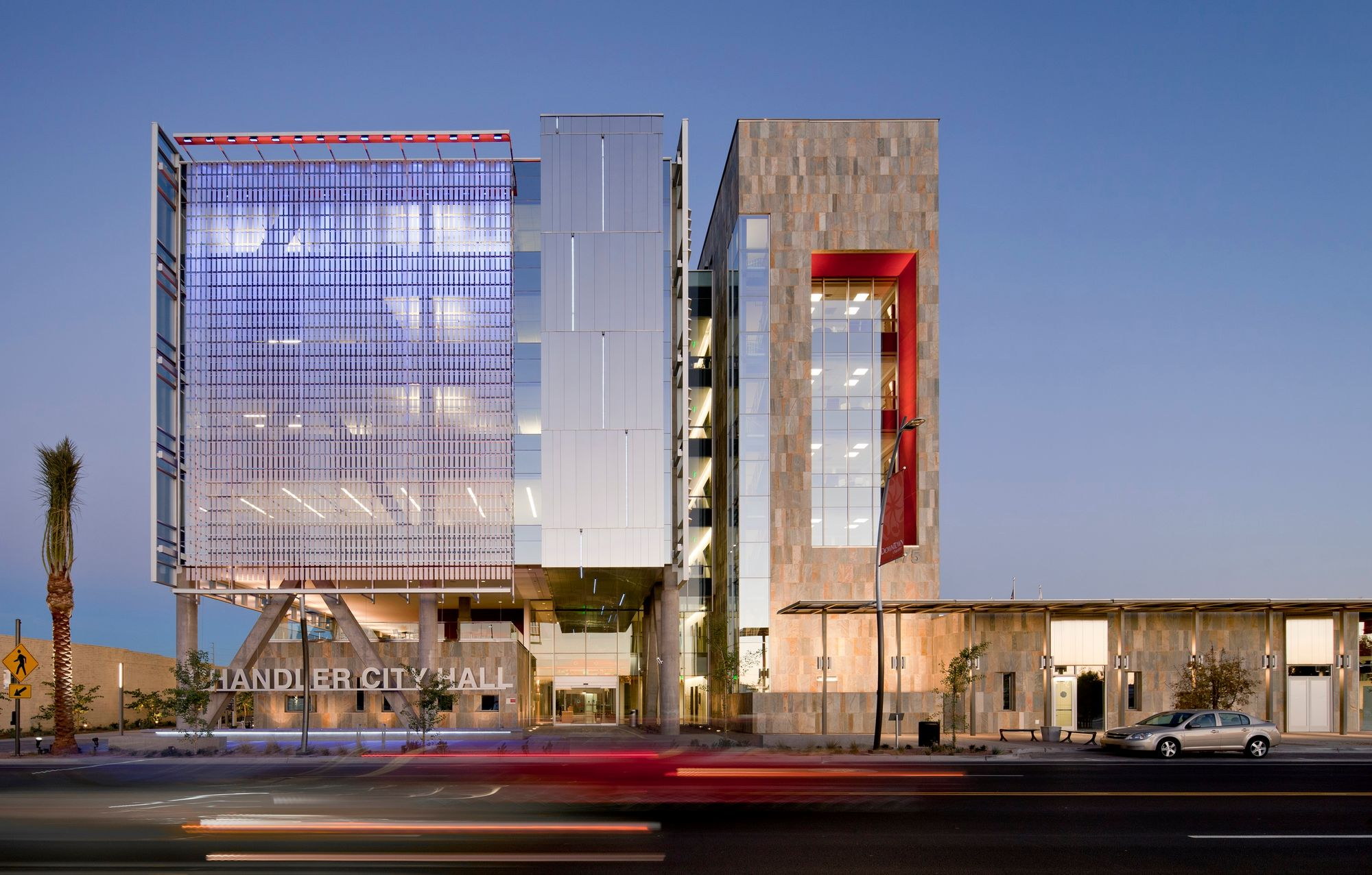 a large perforated metal facade providing sun shade to the Arizona City Hall building