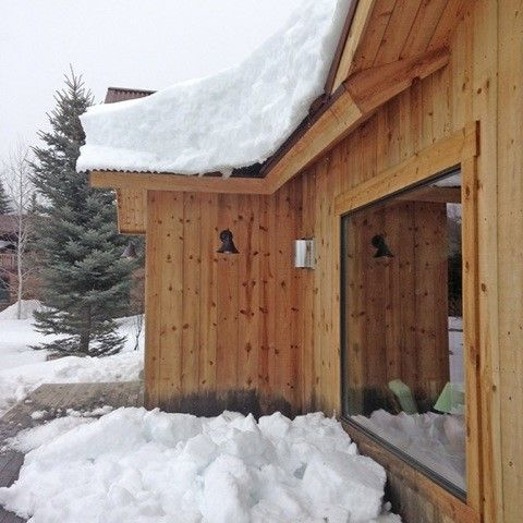 a snowy home in Wymonig in need of a better deck solution