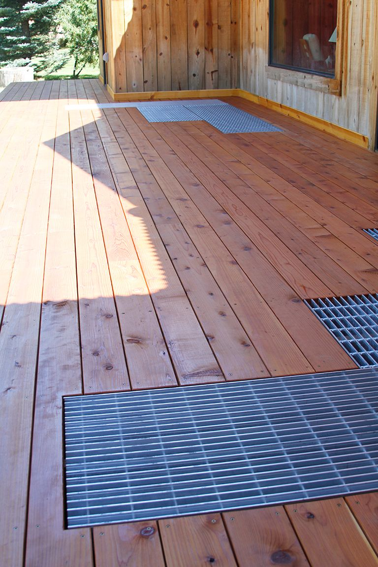 Bar Grating installed into a home deck for drainage purposes