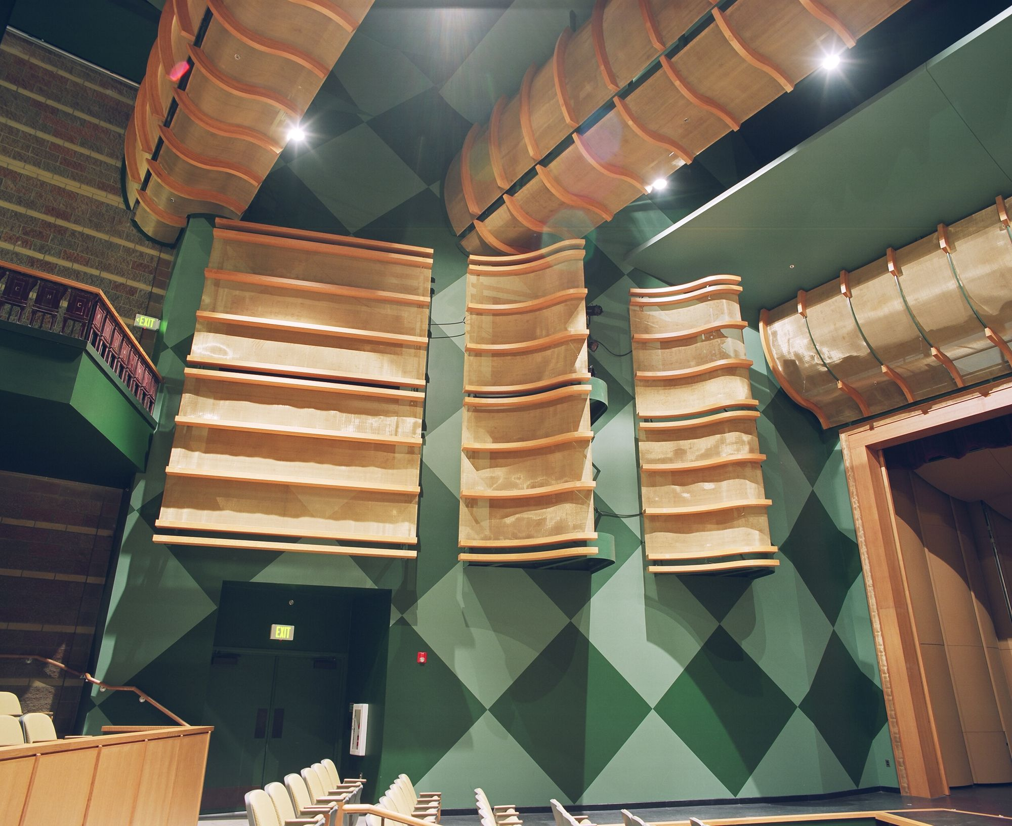 Wire mesh coverings used for proper light diffusion and sound redistribution at the Roosevelt High School Theater