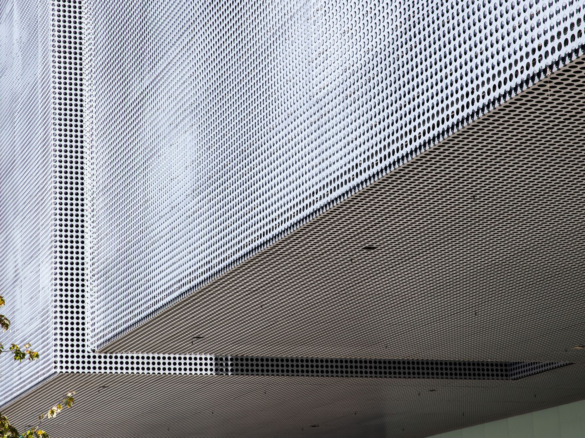 Moiré effect created by layering two offset Perforated panels | Tampa Museum of Art