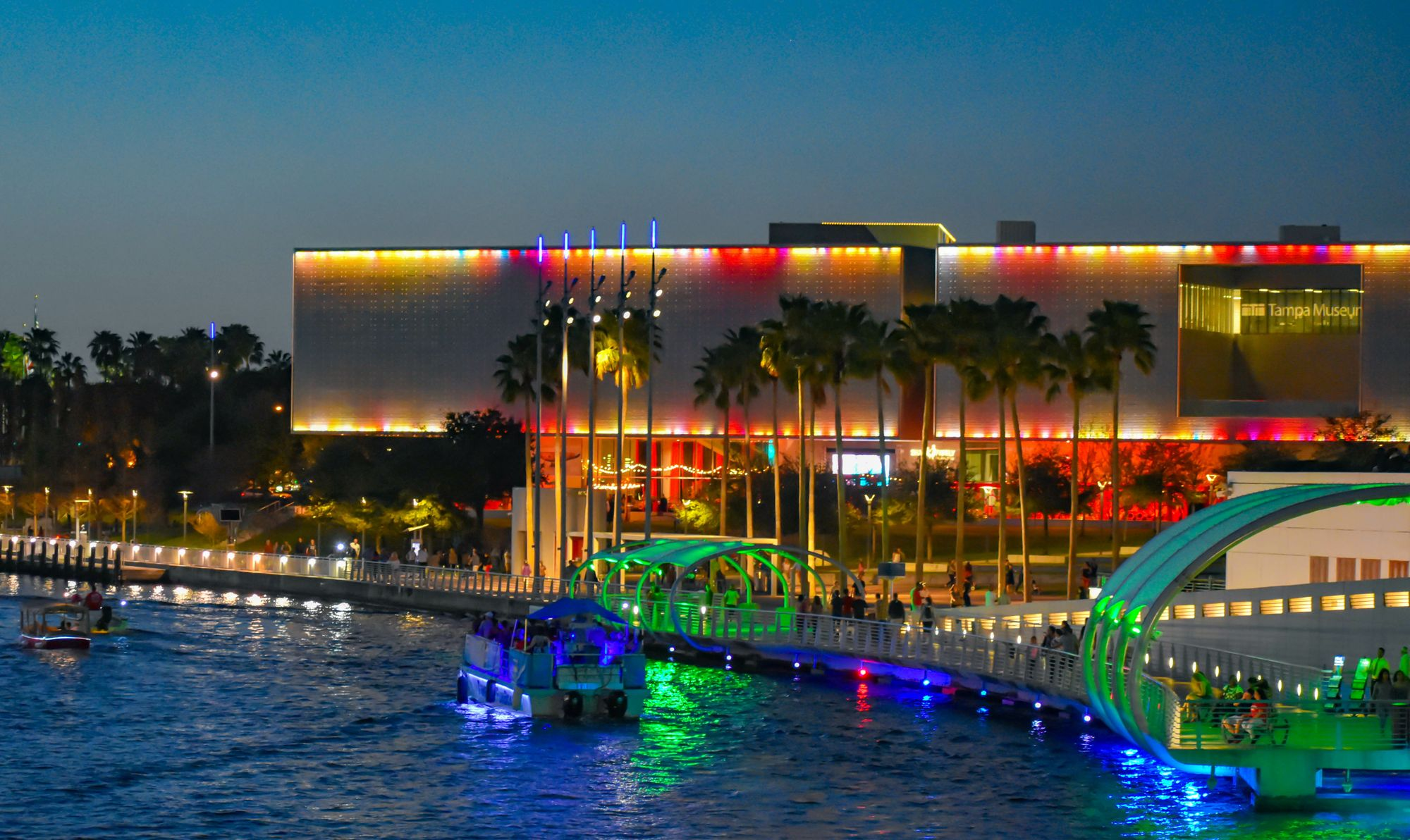 Tampa Museum of Art façade shining with LED lights between Perforated Metal