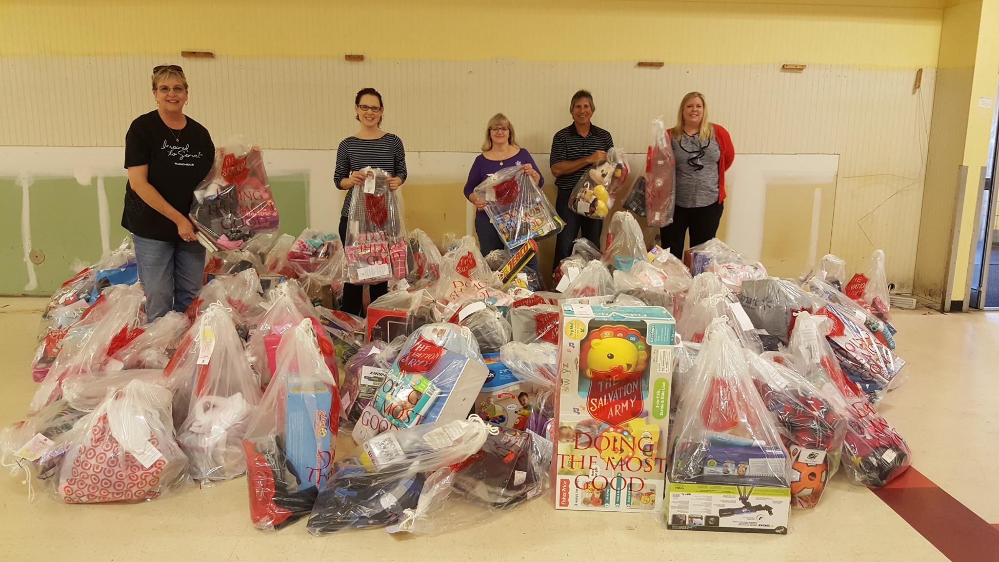 Teri and several McNICHOLS associates in 2016 with donated gifts.
