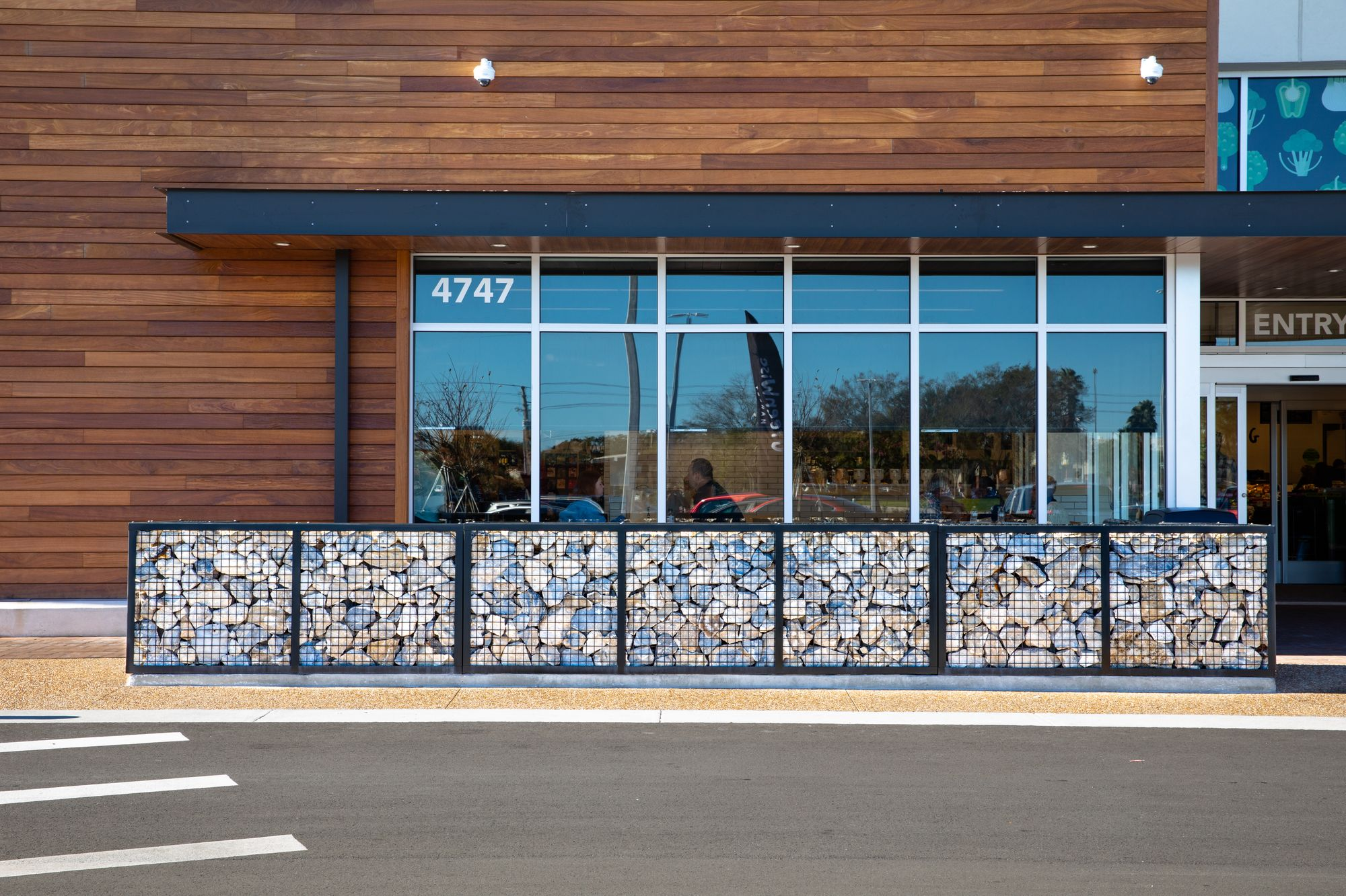 ECO-ROCK® safety barriers line the exterior of GreenWise Market