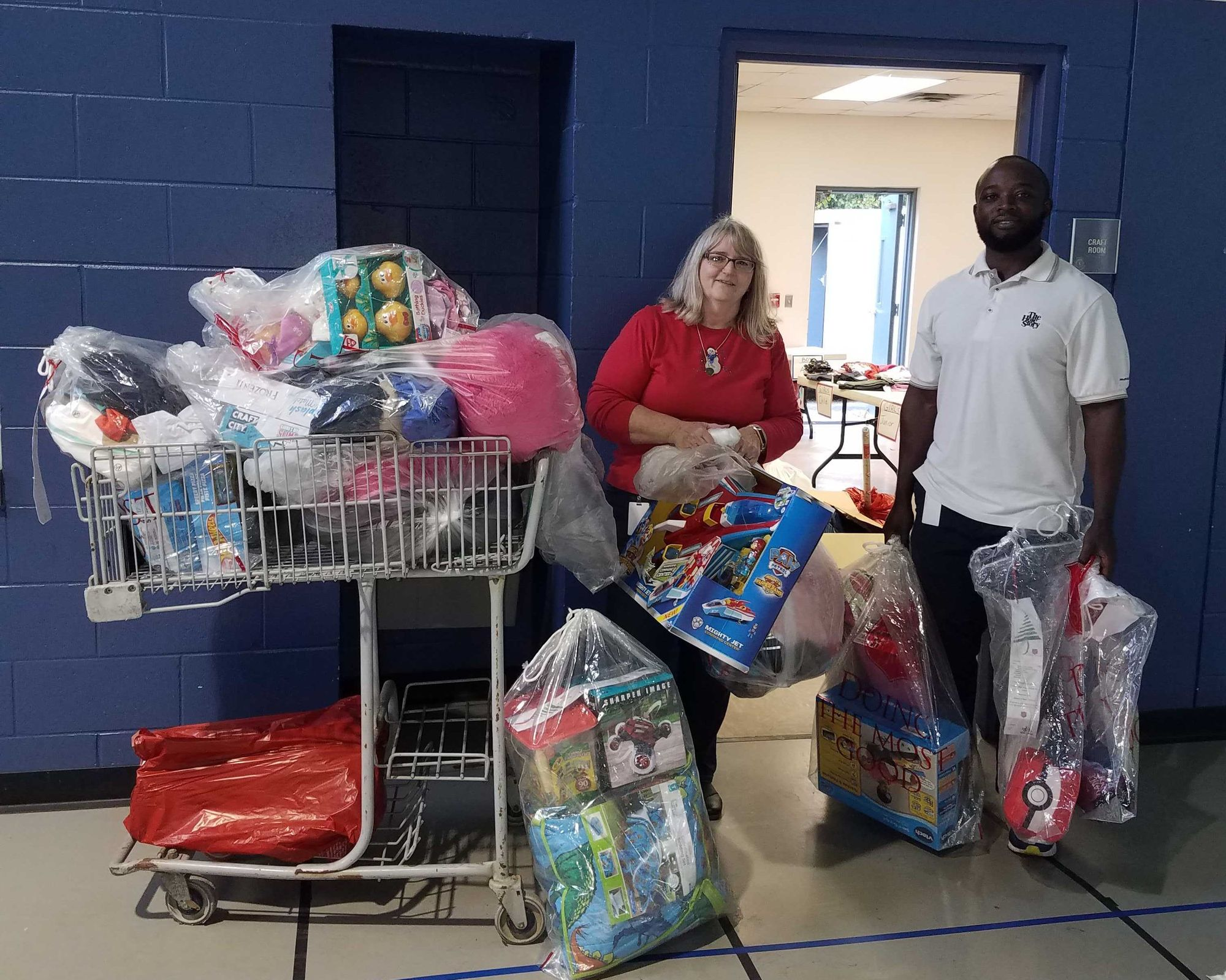 Teri L'Homme bringing donated gifts to the 2019 Angel Tree toy shop