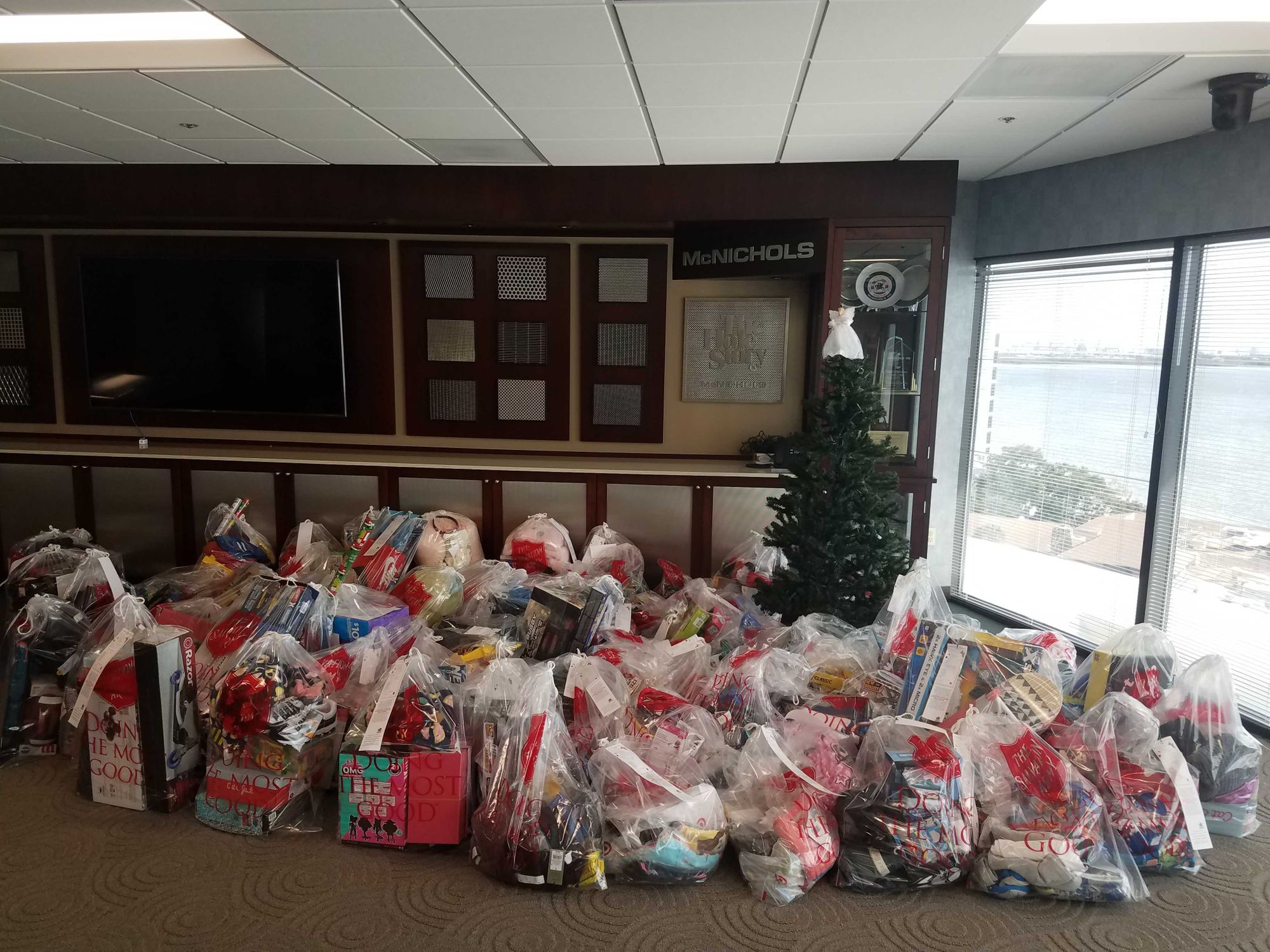 Donated gifts and clothes beneath the 2020 McNICHOLS Angel Tree