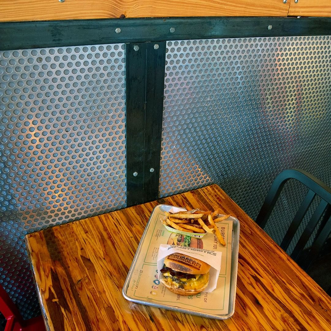 Perforated metal utilized in the dining area of BurgerFi